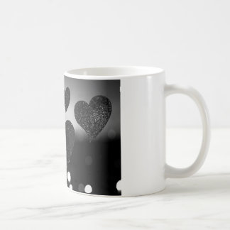 Four love hearts in silhouette night bokeh dof pho tazas