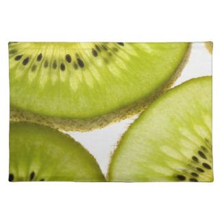 Four pieces of sliced kiwi cloth placemat