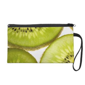 Four pieces of sliced kiwi wristlet purse