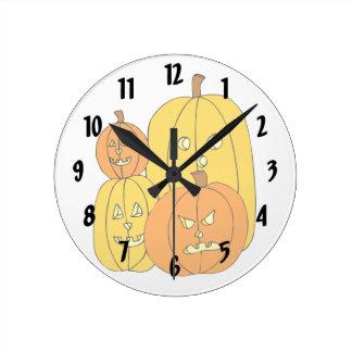 four pumpkin jack o lantern graphic round wall clocks