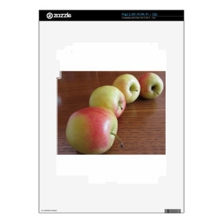 Four ripe apples on wooden table decals for the iPad 2