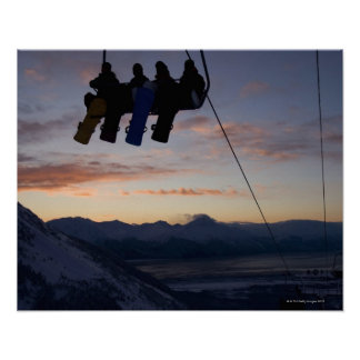 Four snowboarders are silhouetted on a ski lift poster