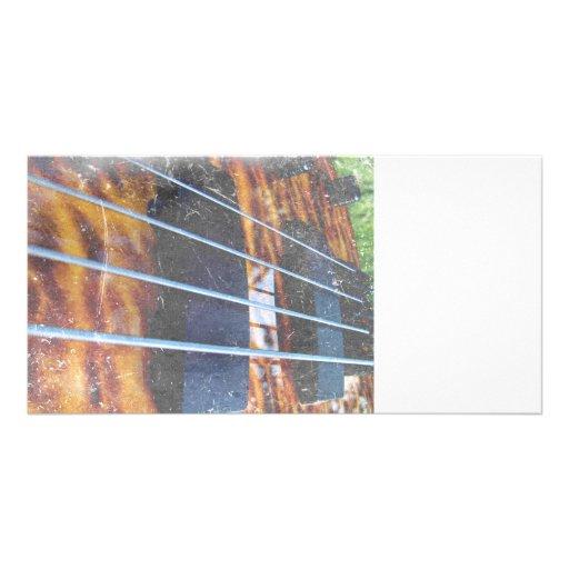 Four string bass bridge close up photo grunge photo card template
