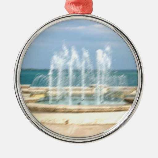 Foutain river sky water coral blur lighten round metal christmas ornament