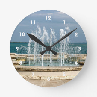 Foutain river sky water coral round clock