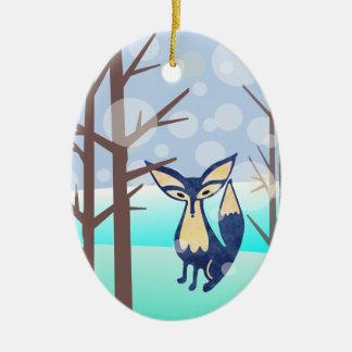 Fox azul en el ornamento de cerámica de maderas adorno navideño ovalado de cerámica