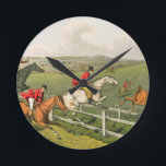 "Fox Hunting, aquatinted by I. Clark, pub. by Thoma Round Clock<br><div class=""desc"">Image:59878  Fox Hunting,  aquatinted by I. Clark,  pub. by Thomas McLean,  1820 (aquatint). Alken,  Henry Thomas (1785-1851). Private Collection,  The Stapleton Collection.  Art,  Fine Art.</div>"