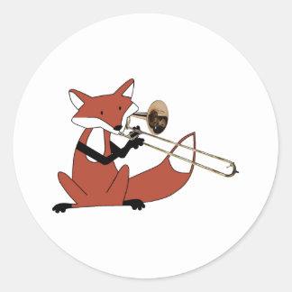Fox que juega el Trombone Pegatina Redonda
