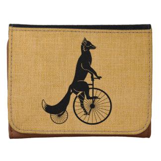 Fox que monta una bici