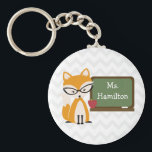 "Fox Teacher At Chalkboard Keychain<br><div class=""desc"">This product for teachers features an illustration of a fox wearing rhinestone studded retro cat eye glasses standing at a chalkboard with a red apple.  Personalize the name.  Background is gray chevron.  Look for matching items at The Pink Schoolhouse.</div>"