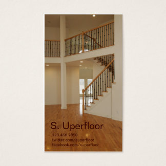 foyer in new construction home with staircase business card
