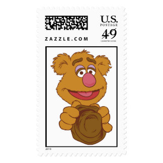 Fozzie Bear Holding Disney Stamps