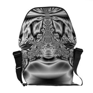 Fractal negro y blanco del metal torcido del bolsa de mensajeria