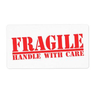 Frágil dirija con las etiquetas de cuidado etiqueta de envío