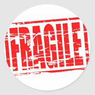 Fragile red rubber stamp effect classic round sticker
