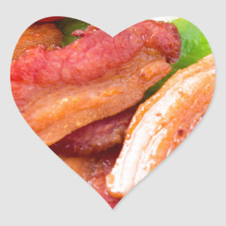 Fragment dish closeup with shredded lettuce, tomat heart sticker