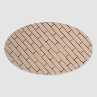 Fragment of a brick wall beige with diagonal image oval sticker