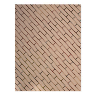 Fragment of a brick wall beige with diagonal image postcard