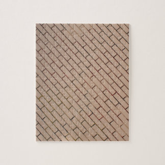 Fragment of a brick wall beige with diagonal image puzzle