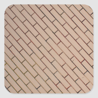Fragment of a brick wall beige with diagonal image square sticker