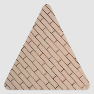 Fragment of a brick wall beige with diagonal image triangle sticker