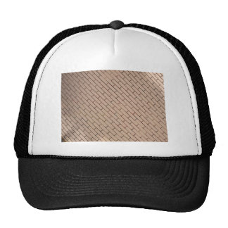 Fragment of a brick wall beige with diagonal image trucker hat