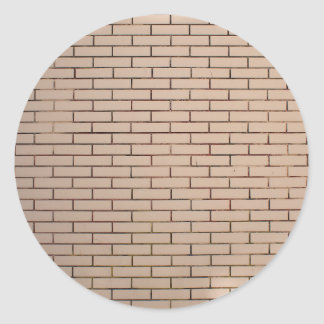 Fragment of a brick wall beige with neat rows of m classic round sticker