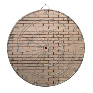Fragment of a brick wall beige with neat rows of m dartboard