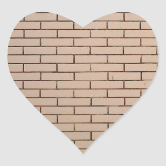 Fragment of a brick wall beige with neat rows of m heart sticker