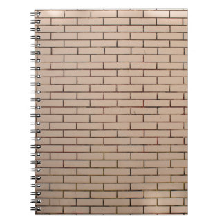 Fragment of a brick wall beige with neat rows of m notebook