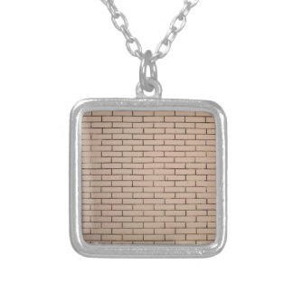 Fragment of a brick wall beige with neat rows of m square pendant necklace