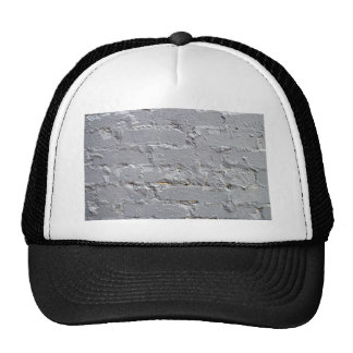 Fragment of a brick wall closeup with gray paint trucker hat