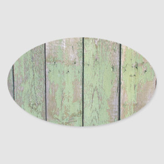 Fragment of a fence from wooden planks oval sticker