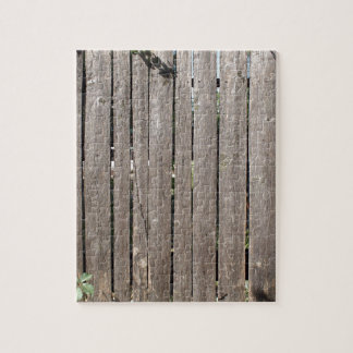 Fragment of a fence from wooden planks jigsaw puzzle
