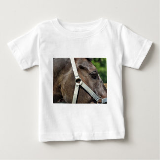 Fragment of a horse's head with a bridle close up baby T-Shirt