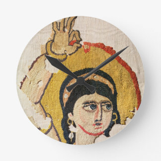 Fragment of a tapestry depicting the head of a dan round clock