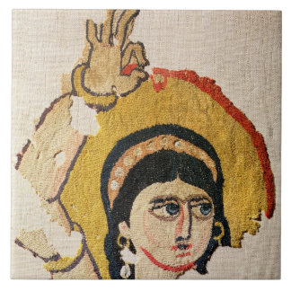 Fragment of a tapestry depicting the head of a dan ceramic tiles