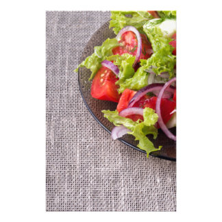Fragment of a transparent plate with a fresh salad stationery
