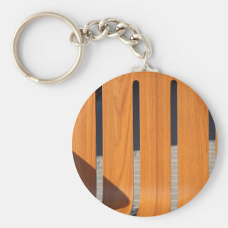 Fragment of a wooden outdoor benches closeup basic round button keychain