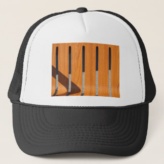 Fragment of a wooden outdoor benches closeup trucker hat