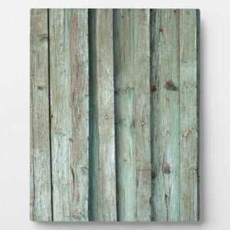 Fragment of an old fence with wooden planks plaque