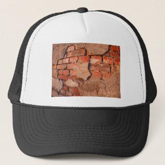 Fragment of an old shabby brick wall trucker hat