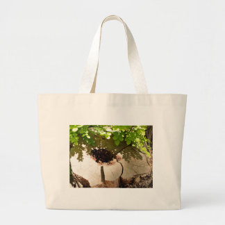 Fragment of an old stump of cut tree that has rott large tote bag