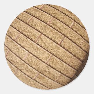 Fragment of decorative brickwork brown classic round sticker