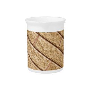Fragment of decorative brickwork brown beverage pitchers