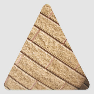 Fragment of decorative brickwork brown triangle sticker