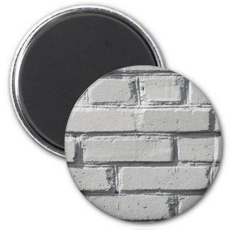 Fragment of gray brick wall closeup magnet