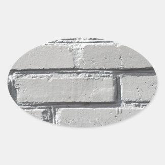 Fragment of gray brick wall closeup oval sticker