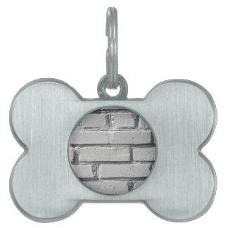Fragment of gray brick wall closeup pet tag