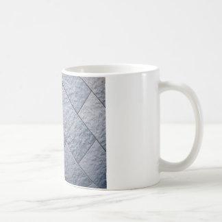 Fragment of gray decorative wall coffee mug